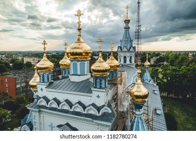 Aerial view on white church with golden towers in city, religion building in Daugavpils, Latvia
