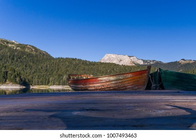 Aerial view on wooden boats at the shore of Black lake in National park Durmitor. Montenegro.