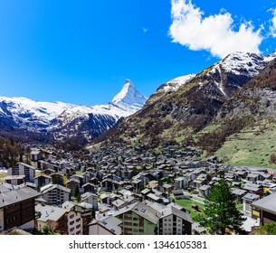 Aerial View on Zermatt village and Matterhorn Peak in background, Switzerland