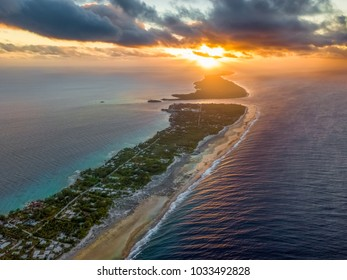 Aerial view of one of the largest atolls in the world, Rangiroa atoll at sunset in Tahiti.