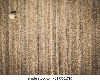 Aerial view of one round hay bale on stubble, view from directly above