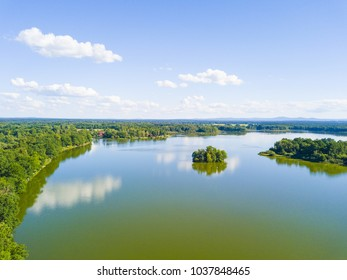 Aerial view of Opatovicky pond with small island in Trebon, South Bohemia, Czech republic, European union. Famous carp breeding lakes and tourist destination with many landmarks.
