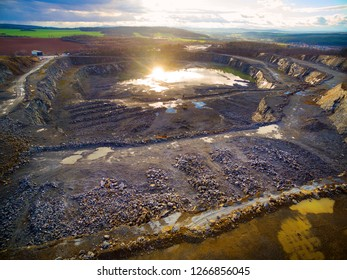 Aerial view of open cast mine at sunset.  Heavy industry from above. Industrial landscape in Central Europe.