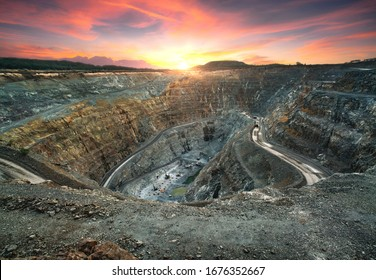 Aerial view of opencast mining quarry with lots of machinery at work - view from above.This area has been mined for copper, silver, gold, and other minerals.