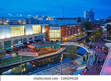 Aerial view of the 'Oracle' shopping centre illuminated at dusk in Reading, Berkshire uk