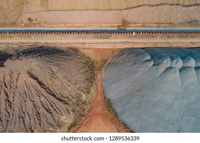 aerial view of ore and conveyor belt at an industrial port