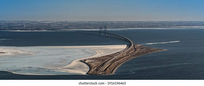 aerial view of Øresund (Oresund) Bridge toward Sweden -  the link between Denmark and Sweden - during a winterly day with parts of baltic sea frozen