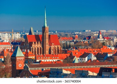 Aerial view of Ostrow Tumski with church of the Holy Cross and St. Bartholomew from St. Mary Magdalene Church in the morning in Wroclaw, Poland