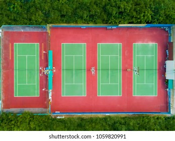Aerial view of outdoor tennis court with tree around