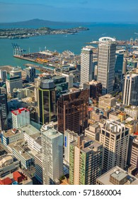 Aerial view over Auckland downtown city center with volcano of rangitoto on the horizon, New Zealand
