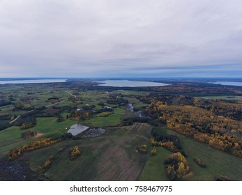 Aerial view over Autumn season woods in Lithuania rural village.