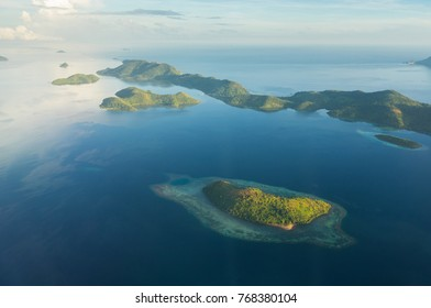 Aerial view over beautiful Philippine islands and deserted beaches.