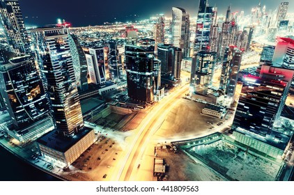 Aerial view over a big futuristic city: Business bay, Dubai, United Arab Emirates. Nighttime skyline. Vintage effect.