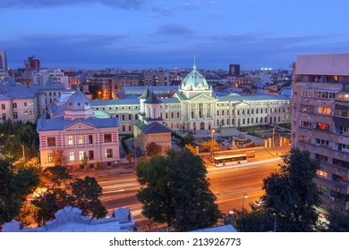 Aerial view over Bucharest skyline with focus on the historic Coltea Hospital complex.