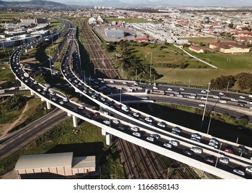 Aerial view over busy interchange at rush hour