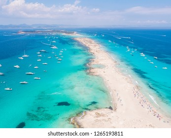 Aerial view over the clear beach and turquoise water of Formentera, Ibiza. During the summer months.