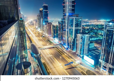 Aerial view over downtown Dubai, UAE.  Nighttime skyline of a big modern city with skyscrapers and highways.