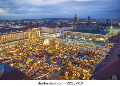 Aerial view over Dresden and Striezelmarkt Christmas market at night, Germany
