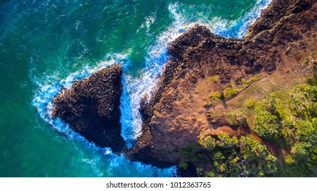 Aerial view over Fingal Head light house and Giants Causeway, NSW Australia. Top down view over the causeway.