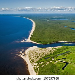 aerial view over the Gauja river outfall, coastline and blue sea