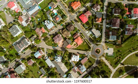 Aerial view over houses in Polish countryside.