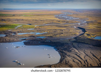 Aerial view over ice lagoons formed due to the glaciers meltdown going on in Iceland, Europe, having as cause the global warming