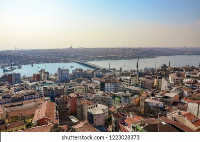 Aerial view over Istanbul city from Galata tower, Turkey. Istanbul is a major city in Turkey that straddles Europe and Asia across the Bosphorus Strait and also a famous tourist destination. - Shutterstock ID 1223028373