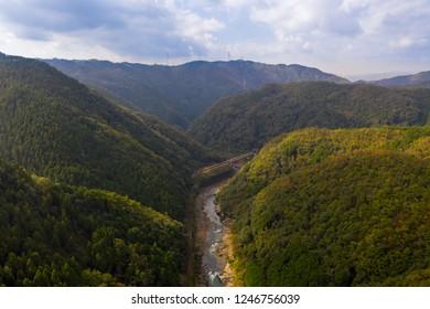 Aerial view over Katsura river near Arashiyama tourist spot in Kyoto Japan near Osaka prefecture. Arashiyama is a nationally designated Historic Site and Place of Scenic Beauty.