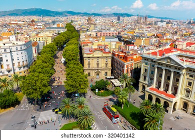 Aerial view over La Rambla from Christopher Columbus monument, with quarters of El Raval to the left and Barri Gotic to the right in Barcelona, Catalonia, Spain