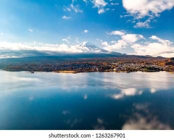 Aerial view over lake Kawaguchi, located in the border Fujikawaguchiko and Minobu, southern Yamanashi Prefecture near Mount Fuji, Japan. Lake Kawaguchi is a very popular tourist spot near Fuji Japan.