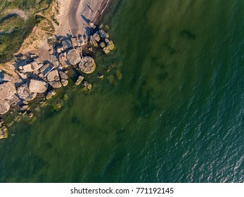 Aerial view over Liepaja Northern Forts, old abandoned fortifications at Baltic sea coast in Latvia. During sunny summer day.