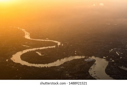 Aerial view over London, England and River Thames at sunset.
