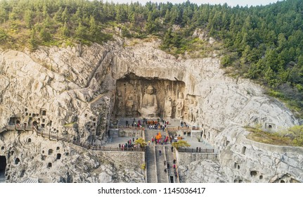 Aerial view over The Longmen Grottoes or Longmen Caves are some of the finest examples of Chinese Buddhist art. Housing tens of thousands of statues of Buddha at Luoyang in Henan province, China.