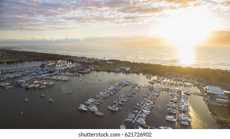 Aerial view over Marina Mirage and boats as the sunrises over the ocean, Gold Coast