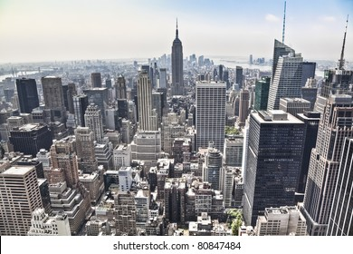 An aerial view over New York city, with the Empire State building in front. Amazing overlook at this big city.