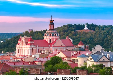 Aerial view over Old town with Church of St Casimir and Three Crosses on the Bleak Hill at sunset, Vilnius, Lithuania, Baltic states.