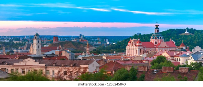 Aerial view over Old town with Gediminas Castle Tower, churches and Three Crosses on the Bleak Hill at sunrise, Vilnius, Lithuania, Baltic states.