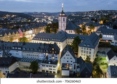 Aerial view over the old town of Siegen at night. North Rhine-Westphalia, Germany
