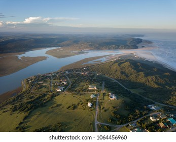 Aerial view over a river and small coastal town