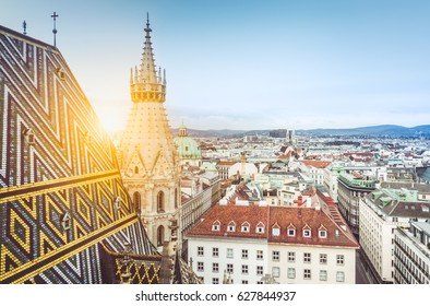 Aerial view over the rooftops of Vienna from the north tower of famous St. Stephen's Cathedral in beautiful golden evening light at sunset with retro vintage pastel toned filter effect, Austria