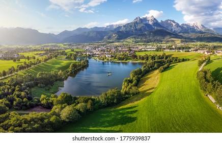 Aerial view over Saalfelden with Steinernes Meer in Summer, Salzburg, Austria - Shutterstock ID 1775939837