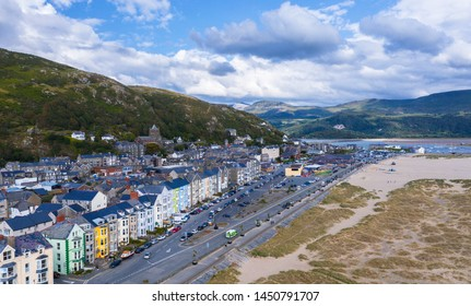Aerial view over scenic coastal town of Barmouth laying on estuary of River Mawddach and Cardigan Bay in North-Western Wales