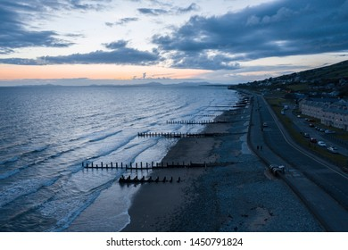 Aerial view over scenic coastal town at stormy twilight in Barmouth, North Wales in United Kingdom