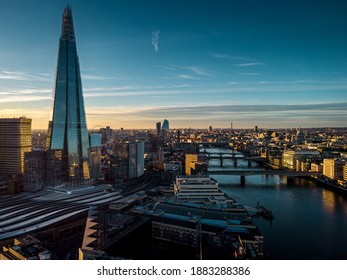 Aerial View over Shard, London Bridge Station, Thames River during sunset
