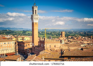 Aerial view over Siena: Mangia tower on piazza del Campo