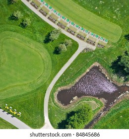 Aerial view over small lake and golf field