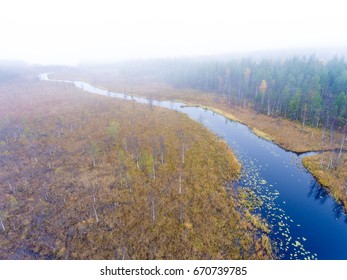 Aerial view over a small river in Finnish Lapland in autumn