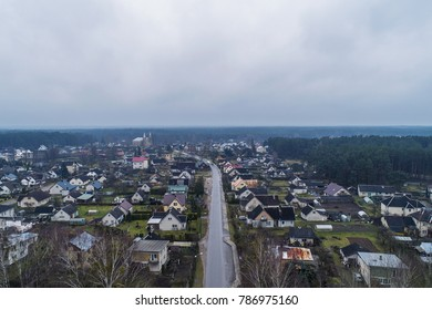 Aerial view over small village Ratnycia, near resort town Druskininkai, Lithuania. During cloudy autumn day.