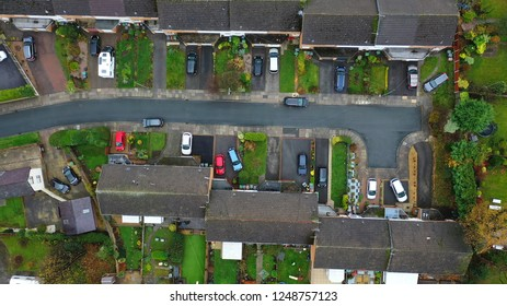 Aerial view over suburban homes and roads in the UK