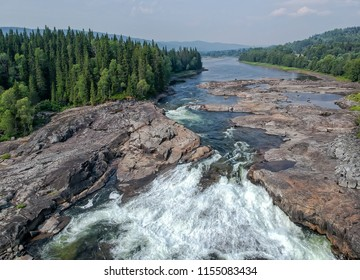 Aerial view over swedish waterfall - Tegeforsen